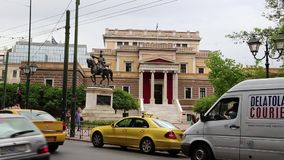 Road traffic near statue of General Theodoros Kolokotronis and old parliament house in Athens, Greece stock footage