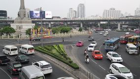 Road traffic near Victory Monument in Bangkok, Thailand. THAILAND, BANGKOK, APRIL 11, 2014: Road traffic near Victory Monument in Bangkok, Thailand stock video footage