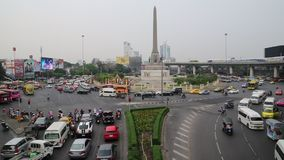 Road traffic near Victory Monument in Bangkok, Thailand. THAILAND, BANGKOK, APRIL 11 2014: Road traffic near Victory Monument in Bangkok, Thailand stock video footage