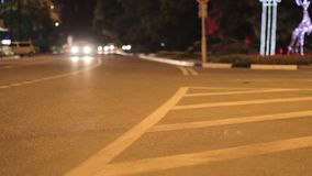 Road with traffic at night with bokeh lights stock video