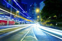 Road traffic at night in Hong Kong Stock Photos
