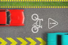 Road traffic offense. Driving by bicycle lane. Concept of biking safety. Top view on road with bike path sign and marks and moving. Blurred cars on it stock images