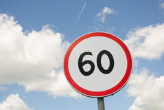 Road traffic round sign limiting speed on blue sky Stock Photo