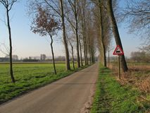 Road with traffic sign. Landscape with a traffic sign stock photography