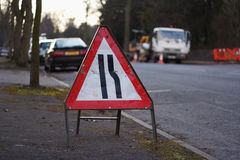 Road traffic sign. Sign for roadworks, with workers vehicle in background royalty free stock images