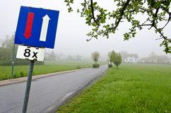 Road with traffic sign give way Stock Image
