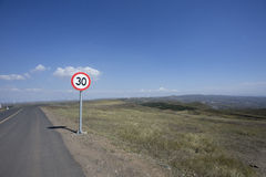 Road and traffic sign in windmill landscape view Royalty Free Stock Image