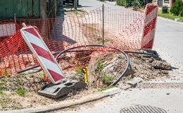 Road traffic sign work ahead with red and white barriers on the street construction site in the city and orange safety net for int. Ernet or telephone royalty free stock photo