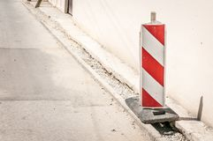 Road traffic sign work ahead with red and white barriers on the street construction site in the city royalty free stock photos