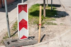 Road traffic sign work ahead with red and white barriers on the street construction site in the city royalty free stock photo