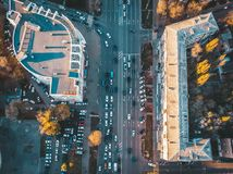 Road traffic on street intersection downtown of European city, aerial or top view. Toned royalty free stock images