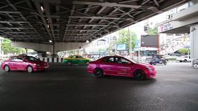 Road traffic under bridge in Bangkok, Thailand. THAILAND, BANGKOK, APRIL 11, 2014: Road traffic under bridge in Bangkok, Thailand stock footage