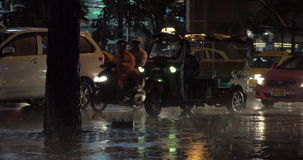 Road traffic under the rain in night city stock video