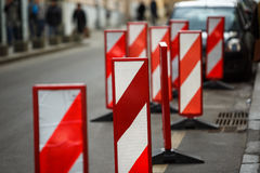 Road traffic works safety pole post obstacle detour sign barrier. Vertical panel under construction warning, red, white diagonal striped signage, large Stock Images