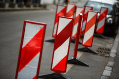 Road traffic works safety pole post obstacle detour sign barrier. Vertical panel under construction warning, red, white diagonal striped signage, large Stock Photography