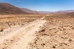 Road trail desert crater stone walls landscape, Middle East. Stock Photos