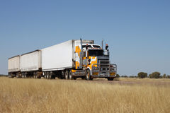 Road Train. In the Australian Outback with 3 trailers royalty free stock photography