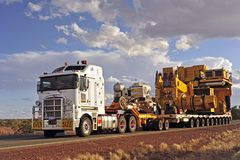 Overwidth Roadtrain on Way to Newman. stock photos
