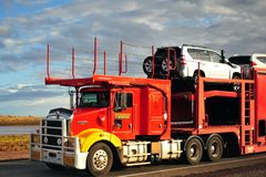 Road train transporting cars to the North of Western Australia. royalty free stock photo