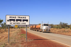 Road Train Warning Sign and Roadtrain Stock Photo