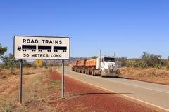 Road Train Warning Sign and Roadtrain stock photo