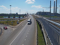 Road and tram bridge over the river. View of the city transport junctions, roads, road signs, delivery of cargo, heavy machinery, the trucks Stock Photo