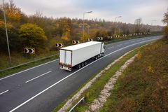 Road transport. Articulated lorry on the road. Road transport. Articulated lorry in motion on the road stock images