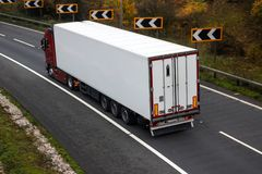 Road transport. Articulated lorry. In motion on the road royalty free stock photos