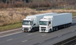 Road transport - lorries on the motorway Stock Photos