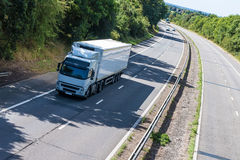 Road transport - lorry on the road royalty free stock image