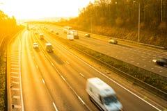 Road transport - Sunset above motorway Stock Image