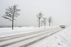 Road transport in the winter. Road transport in the winter in a snowfall Royalty Free Stock Photos