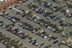 Parking Lot Aerial View. Aerial view of a parking lot with many cars in rows Stock Images