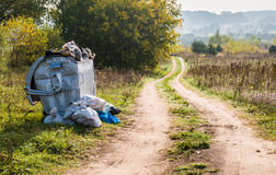 Road and trash container Royalty Free Stock Photography