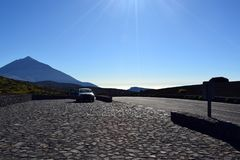 Road travel concept with car and Teide Peak in Tenerife Royalty Free Stock Images