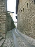 The road less traveled in Italy. Back alley in Cividale Italy.  This road was created in the late BC era Royalty Free Stock Photography