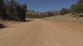 The road less traveled in New Mexico. This Grant county road in southwest New Mexico winds it`s way through the back country on the way to White Signal near stock footage