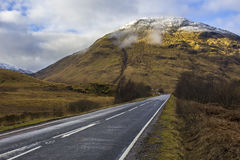 The Road Less Travelled in Glen Coe Valley, Scotland. A lonely road in winter in the Glen Coe Valley within the Scottish Highlands Royalty Free Stock Photos