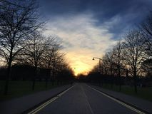The road less travelled. Sunset at Glasgow Green Stock Photos