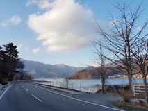 The road that traverses the rivers and mountains Has a calm atmosphere During the daytime In japan stock photos