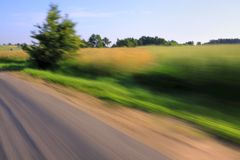 Road and tree with motion blur Stock Image