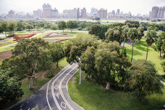 Xindian Creek bicycle lanes. The road with the trees and the grass in the park stock image