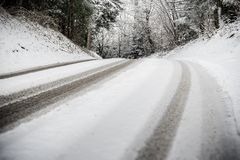 Road with trees and snow stock photos
