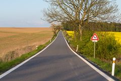 Road with trees in spring. Rural countryside landscape Royalty Free Stock Images