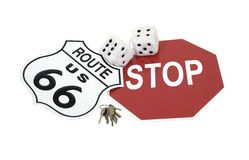Road trip. Shown by road signs, fuzzy dice and a set of keys - path included stock photo