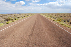 Road trip. Long asphalt road with a cloudy sky Stock Photo