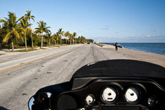 Road Trip. Travelling on a Harley Davidson on Key West seaside with palm trees in a sunny day - Road trip to Key West (2010 - USA Royalty Free Stock Photos