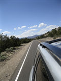 Road Trip. Paved road in the desert in oblique angle Stock Photos
