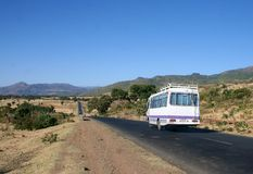 Road Trip. A van driving along towards the mountains in Ethiopia Stock Photo