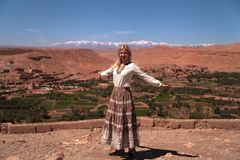 Girl in front of the panoramic view of the High Atlas Mountains royalty free stock photography
